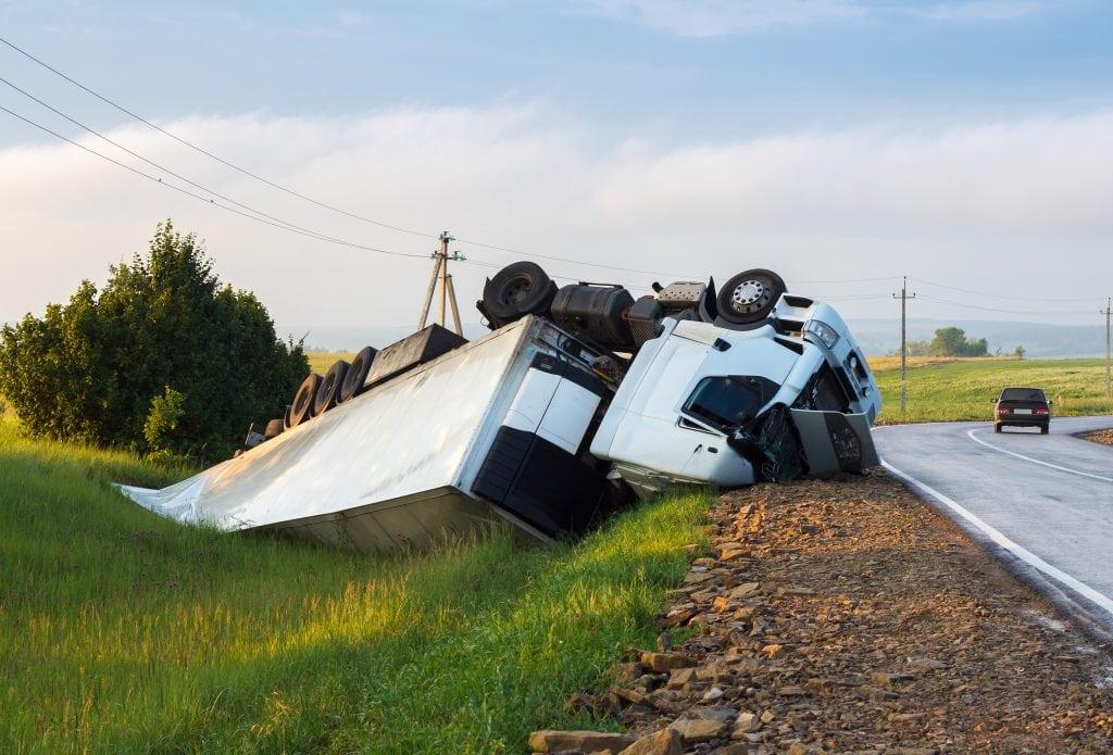 semi-truck rollover accident